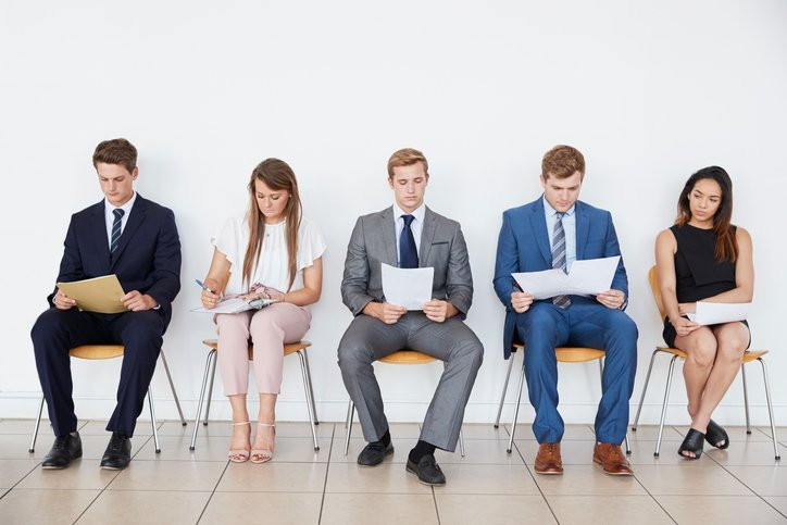 Candidates in smart dress for a legal interview