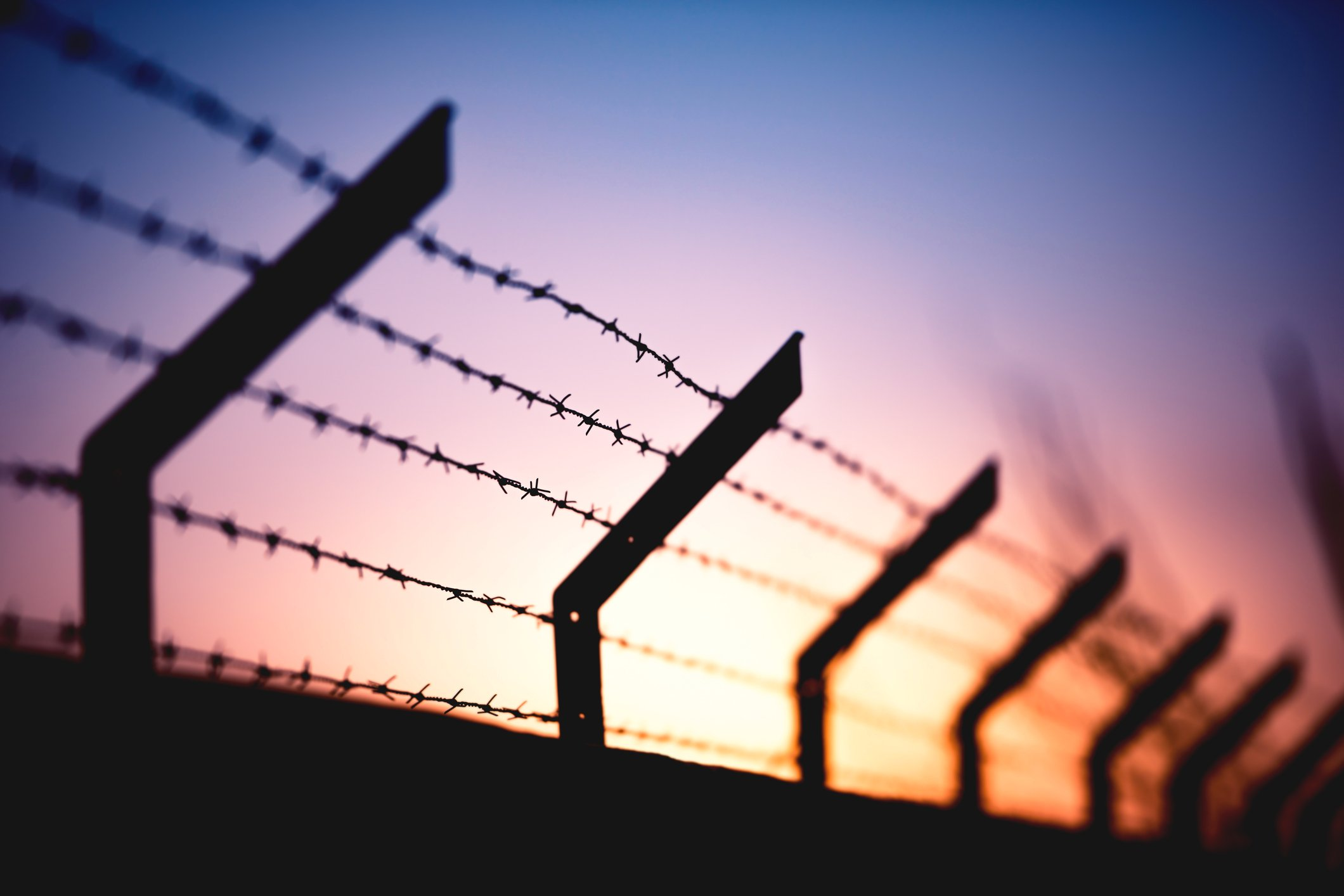 legal news around prisons barbed wire fence