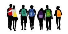 A bunch of students walk together with colourful backpacks on their back