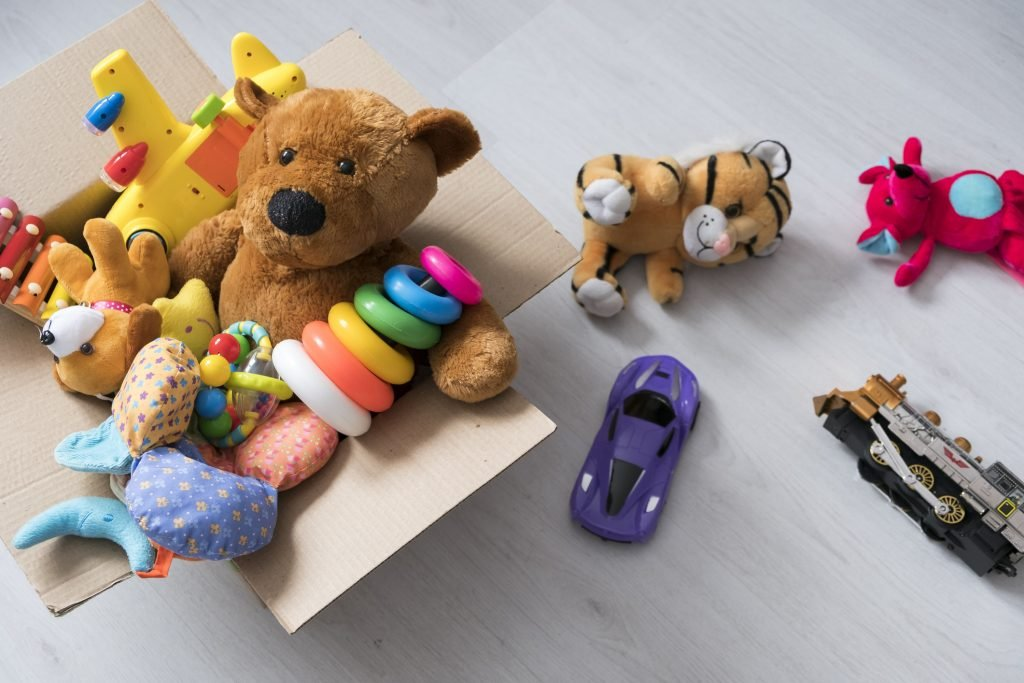 A mixture of toys in a cardboard box