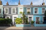 Row of terraced houses in different shades of blue