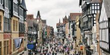 Study law in the UK - English High street lined with Tudor architecture