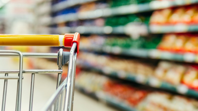 Supermarket aisles and close up of a trolley
