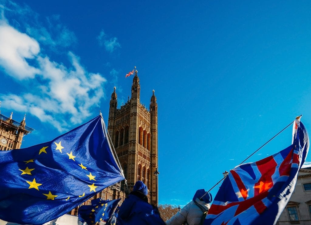 People holding EU and UK flags protesting suspension of parliament
