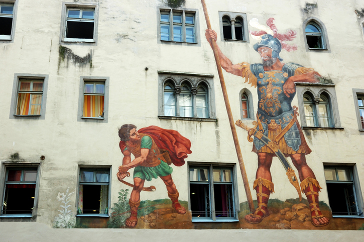 Mural of David and Goliath on a building
