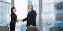 Law firm meeting man and woman shaking hands standing