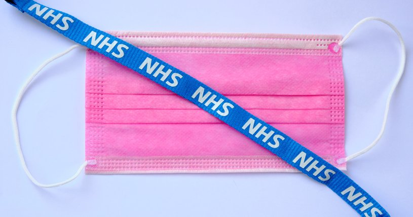 Surgical mask with NHS lanyard on top