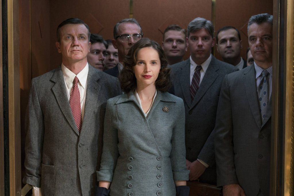 Felicity Jones playing Ruth Bader ginsburg surrounded by male lawyers