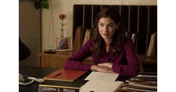 Michelle Monaghan sitting at a desk in an office